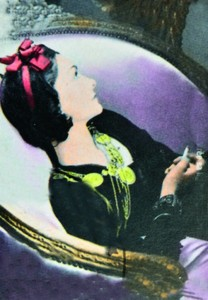 GUINEA - CIRCA 1998: a stamp printed in Republic of Guinea commemorating Coco Chanel created her perfume line, circa 1998.